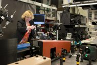 Angela Hight Walker, PML, places a sample for Raman Spectroscopic characterization.