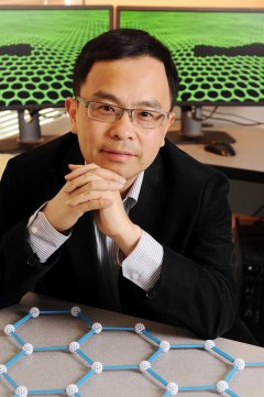 Ting Zhu an associate professor in the George W. Woodruff School of Mechanical Engineering at Georgia Tech, is shown with a model of the graphene structure. Georgia Tech's calculations and physical experiments at Rice University led to the conclusion that graphene, the one-atom layer of carbon, is only as strong as its weakest link. (Credit: Georgia Institute of Technology)