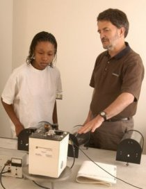 Wayne Pennington (right) demonstrates seismic imaging equipment for a student.